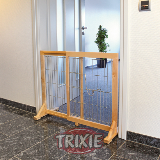 Barrera extensible para puertas y escaleras barrera para for Puerta seguridad perros